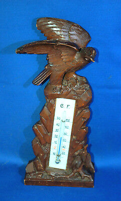 A antique Victorian well carved wooden Black Forest sparrowhawk bird thermometer