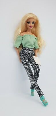Dolls' boutique outfit for Barbie or fashion royalty