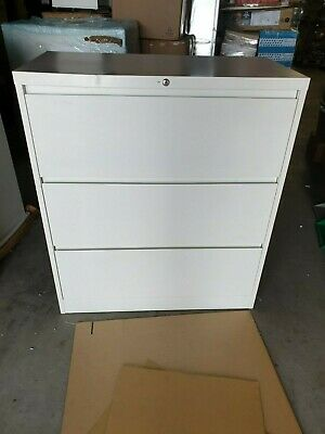 3 Drawer Lateral Filing Cabinet White New with keys has minor Dent few scratches