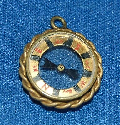 An attractive antique small working pirate fob compasss, twisted brass frame