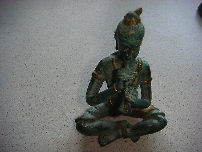 vintage well cast  bronze /brass crossed legged man playing a flute / pipe