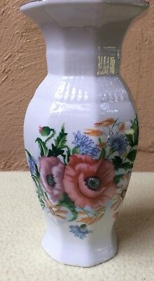 Elegant White Vase With Flowers