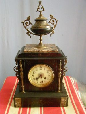 Old marble and brass clock  pendulum mechanism with striking