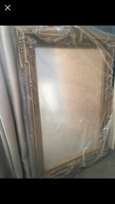 Large ornate antique style gold mirror 47 X 30