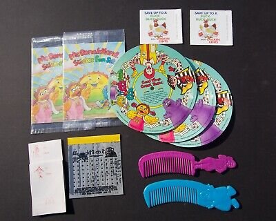 Assorted McDonald's items: combs records stickers punch-outs and more 1989
