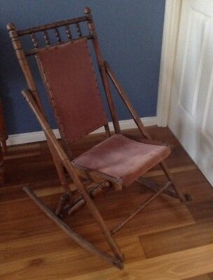 Antique style rocking chair folds to store, light burgundy upholstery