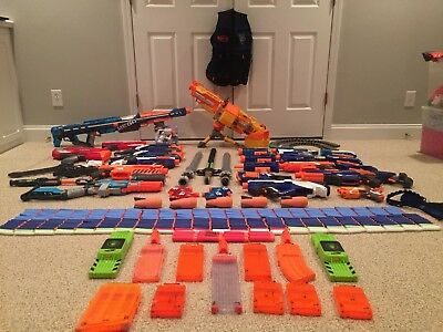 Large Nerf Gun Lot (23 Guns) With Swords, Darts, Clips, and accessories
