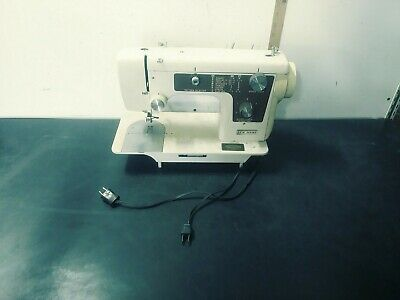 Vintage New Home sewing machine model 641, Belt drive, tested motor runs