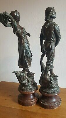 A Pair of Continental spelter Fishing figures