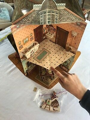 A three dimensional Victorian doll house in a pop-up book