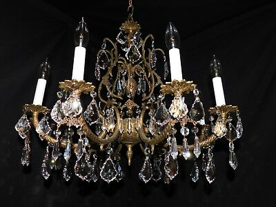 Antique brass chandelier 8 lights quality lead crystals.