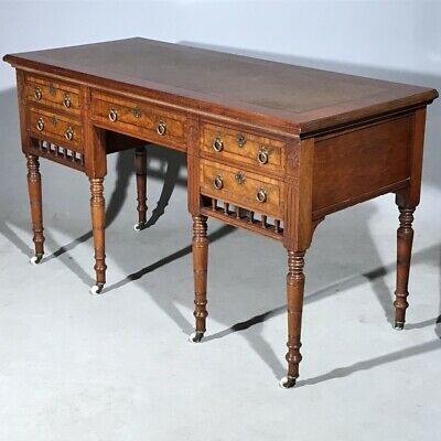 Antique desk in solid mahogany with leather top