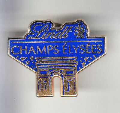 Rare Pins Pin's .. Aliment Food Chocolat Lindt Paris Champs Elysees Arthus B.~Ck