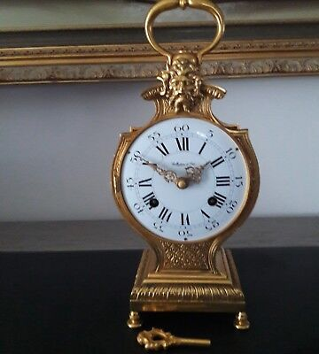 Pendule cartel en bronze collection d'art - Horloge
