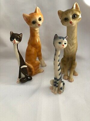 Collection of 4 Long Necked Resin Cats