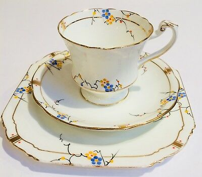 Paragon Vintage china tea cup saucer set trio English white blue yellow
