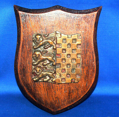 A rare antique oak backed medieval gothic heraldic shield shaped plaque