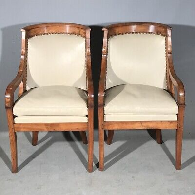 Exceptional pair of antique French walnut and leather armchairs