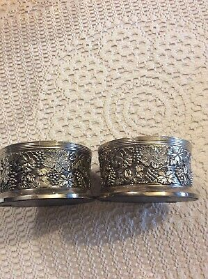 Two vintage silver plated wine bottle holders