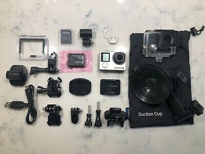 GoPro Hero4 Black Edition 64 GB Camcorder - Silver. 2x Batteries & Accessories
