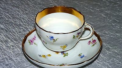 Antique Meissen Germany  White with scattered flowers cup and saucer