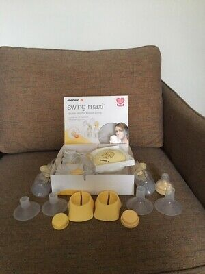 Lightly used medela swing maxi double electric breast pump + 2 sizes of Flange
