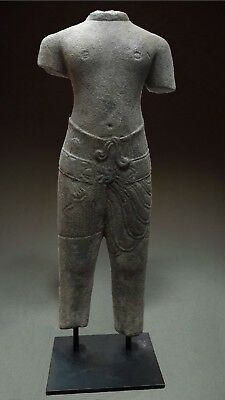 KHMER SANDSTONE TORSO OF A MALE DEITY 'BAPHUON' STYLE. STONE. CAMBODIA 12th C.