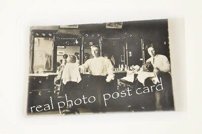 1880's RPPC Barber Shop BackBar Chairs Cabinets Tonic Bottles authentic original