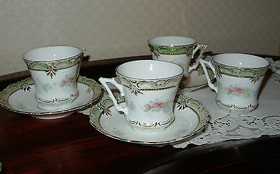 Vintage 4 coffee or tea cups and saucers maybe Limoges