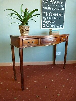 Antique Edwardian serpentine console table in mahogany