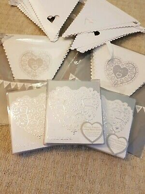 Selection Of silver and white Wedding Day Accessories. Lottery card holders.
