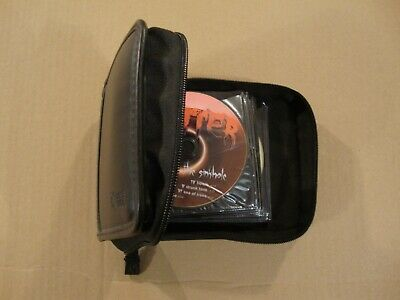 Case Logic CD Organizer, Case - HOLDS 24 CDS, has 18 discs with writing on them