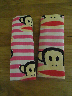 Pre-Owned:  2 x PINK & WHITE MONKEY DESIGN PADDED SEAT BELT PAD/ STRAP COVER