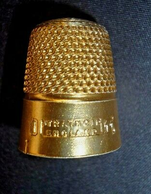 """Antique """"stratnoid England"""" Gold Thimble And A Silver And Plastic Thimble"""
