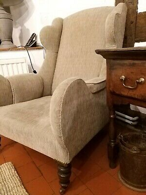 A Large Early 19th Century Wing Backed Country House Armchair