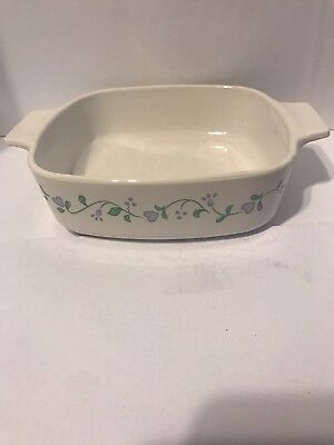 Vintage quart Casserole cornin wear dish no lid. Nine Inches Across.
