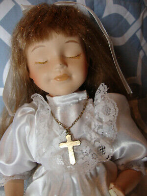 """An 11 inch, kneeling/ praying, """"First Communion"""" porcelain doll"""