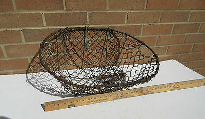 Vintage agricultural worn rusty wire metal mesh garden display basket planter