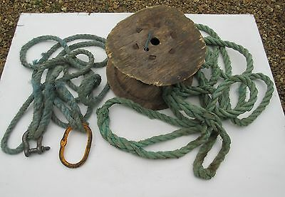 old / modern worn used grubby greeny blue nylon? tow ropes wooden reel nautical