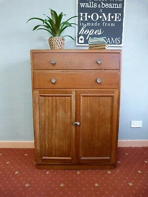 Vintage tallboy cabinet with drawers in walnut and teak mid century