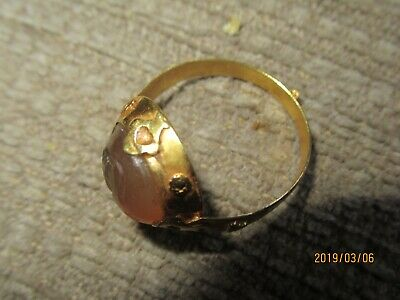 Antique middle eastern high carat   gold ring with chacedony intaglio