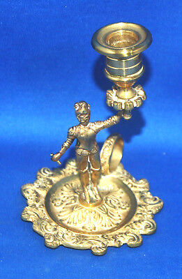 An antique brass Victorian gothic chamber candlestick, armoured knight