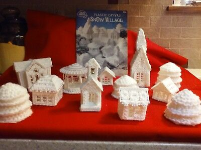Assembled 12 pc Plastic Canvas Snow Village and design book, excellent condition
