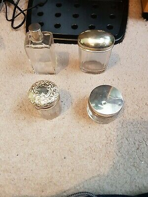 Antique silver topped bottles