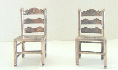 """Antique Sterling Pair of Miniature Chairs.  Hallmarked.  2' by 1"""".  Great pair."""