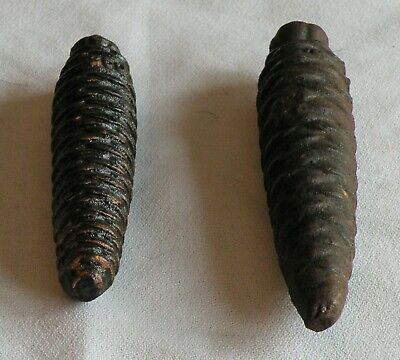 2 VINTAGE PINE CONE CUCKOO CLOCK WEIGHTS -1 marked 320; 1 marked 250