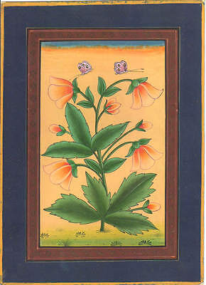 An old antique look miniature paper painting of mughal style flowers