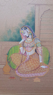 An old antique look mughal style miniature paper painting of a lady with hookah