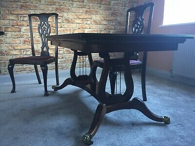 Antique extending mahogany dining table, with glass top protector, and 4 chairs