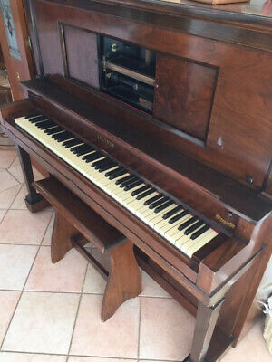 Lagonda pianola with seat and music rolls